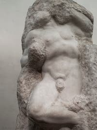 Michelangelo, Awakening Slave Prisoner, marble sculpture for Pope Julius II's Tomb, Accademia Gallery in Florence in Italy