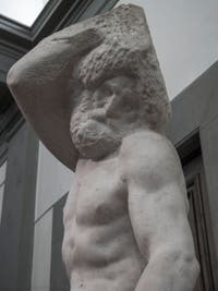 Michelangelo, Bearded Slave Prisoner, marble sculpture for Pope Julius II's Tomb, Accademia Gallery in Florence in Italy