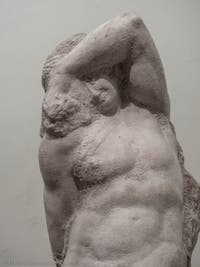 Michelangelo, Young Slave Prisoner, marble sculpture for Pope Julius II's Tomb, Accademia Gallery in Florence in Italy