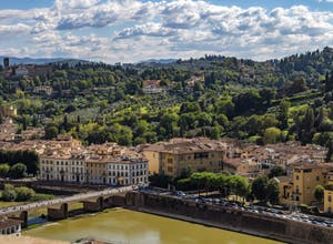 The Arno River and the San Miniato al Monte Church in Florence in Italy