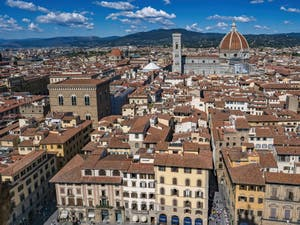 The Piazza della Signoria Square, the Giotto Bell Tower and the Duomo, seen from the Palazzo Vecchio Tower in Florence in Italy